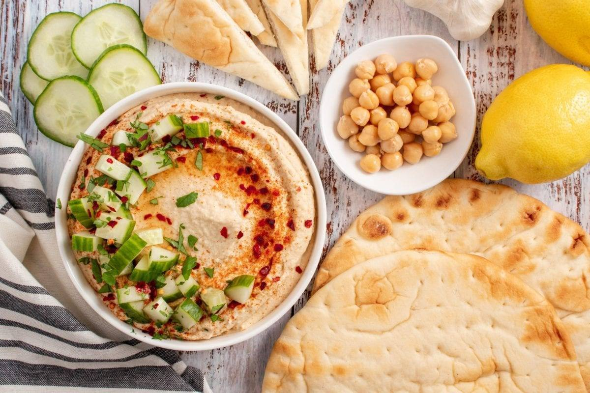 Roasted Garlic Hummus topped with Cucumbers served with pita