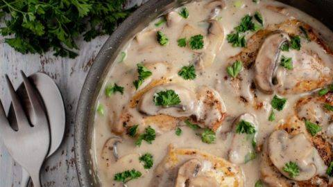 Cream of Mushroom and Chicken in a large sauce pan sprinkled with parsley