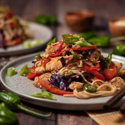 Coconut Thai Chili Noodle Bowl an Easy Chicken Recipe served on a grey plate