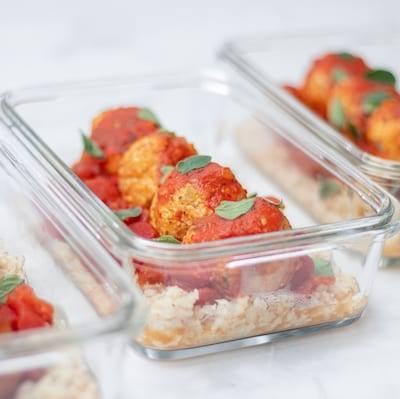 Spicy Chicken Meat balls with Riced Cauliflower served in meal-prep containers