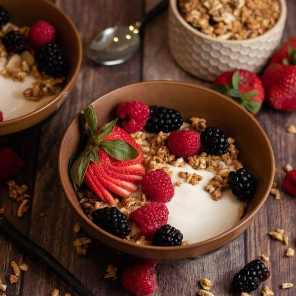 Berry Yogurt smoothie bowl topped with berries and granola