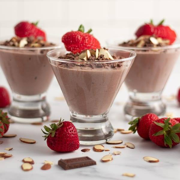 Chocolate Almond Yogurt Parfait served in a martini glass with chocolate shavings and almonds tossed around