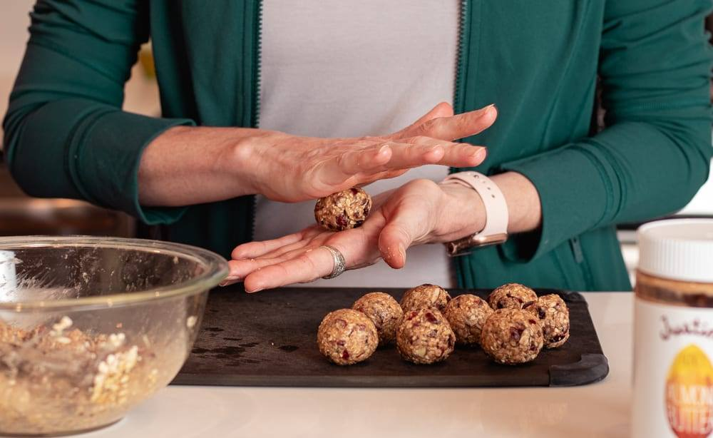 Cranberry Oatmeal Peanut Butter Bliss Balls in a blue bowl Cooking Healthy Recipes